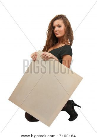 Long-haired Girl Holds An Empty Poster