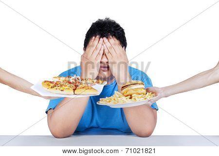 Fat Man Rejecting Junk Food 2