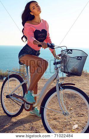 Beautiful Sensual Girl With Dark Hair With Bicycle
