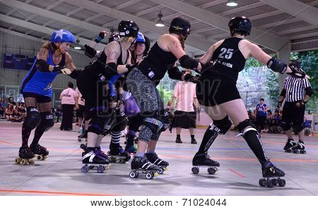 Jammer Approaches The Pack In Roller Derby Match