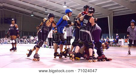 Jammer Passes The Pack In Roller Derby Match