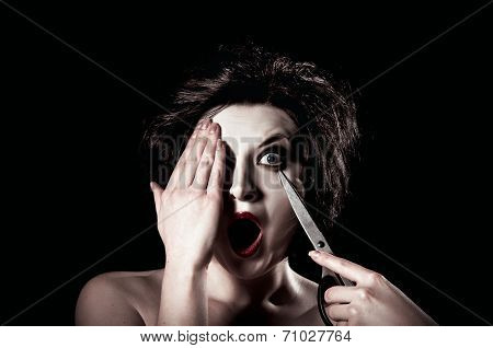 Beautiful Young Woman Poking Her Eye Out With Scissors