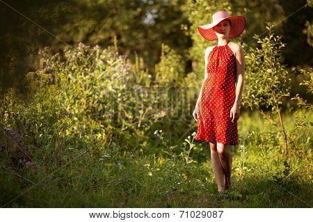 Woman In A Hat Walks Barefoot
