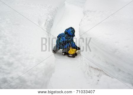 Boy Playing With Toy Truck In Deep Snow