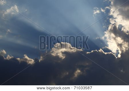 Sun Rays Through Storm Clouds