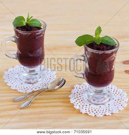Acai Pulp With Fresh Mint In Glass On Crochet Doily