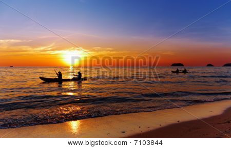 Seascape With Kayakers At Sunset