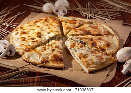 Pieces of Pizza Calzone with Mushrooms