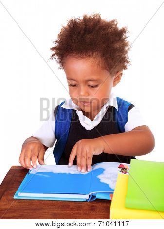 Portrait of sweet little black boy reading books isolated on white background, preparation to go to first class, back to school concept