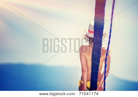 Vintage photo of beautiful female tanning on the yacht, active lifestyle, back side of sexy tanned woman body, luxury sea cruise, traveling and tourism concept