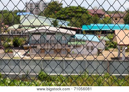 Metallic Net With House Background