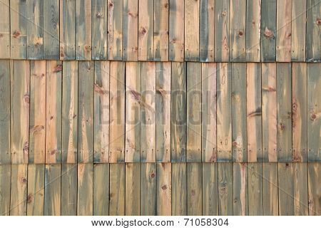 Wooden wall assembled of boards with nodes