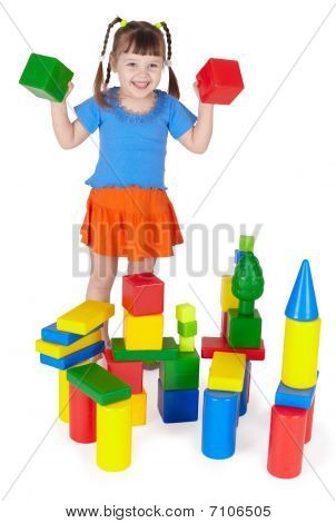 Cheerful Girl Playing With Colored Blocks