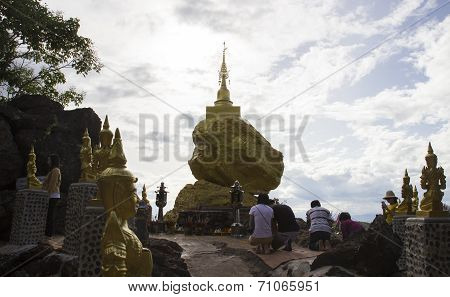People Worship Asian Pagoda On The Stone On The Cliff