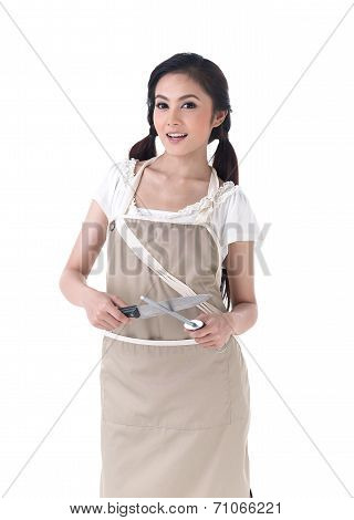 Woman Sharpening A Knife With Steel Sharpener