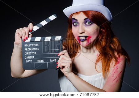 Satan halloween concept with movie clapper board