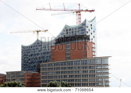 HAMBURG, GERMANY - AUGUST 31, 2014: Elbphilharmonie, philharmonic orchestra hall under construction, harbour city. Municipal financial planning disaster.