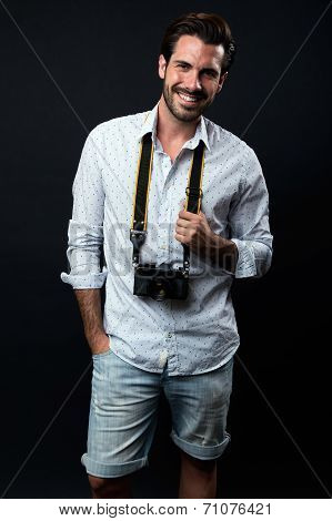 Young Tourist Man With Vintage Photo Camera. Isolated On Black.
