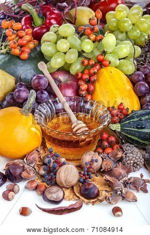 Autumn fruits with honey