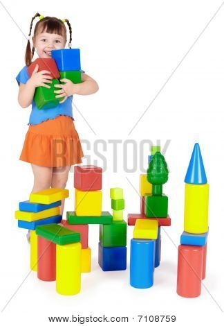 Happy Child Builds A Castle Out Of Blocks