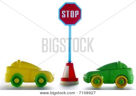 A Couple Cars Behind Stop Road Sign