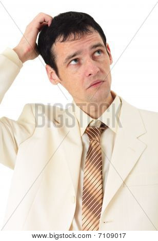 Puzzled Man Scratches His Head, Isolated On White