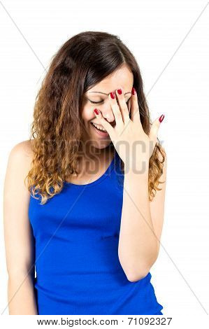 embarrassed girl covers her face with palm