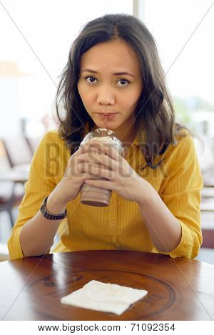 Young Pretty Asian Drinking Whipped Coffee Cream In Cafe
