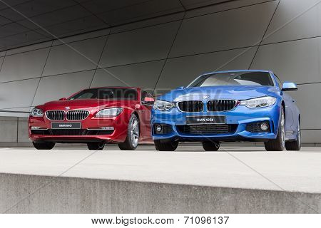 Red 640I And Blue 425D Wet After Rain Bwm Autos