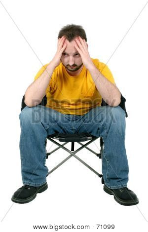 Casual Man With Headache Or Upset Over White