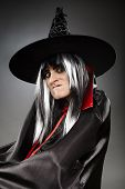 pic of sorcerer  - Closeup portrait of a sorcerer with hat and cape over gray background - JPG