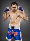 stock photo of muay thai  - Kickbox or muay thai fighter in guard stance - JPG