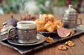 foto of baklava  - Cup of coffee with baklava on metal oriental tray
