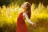 stock photo of beatitudes  - Happy young woman in red summer dress - JPG