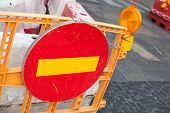 stock photo of no entry  - Round red sign No Entry mounted on the road barrier - JPG