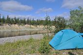stock photo of tent  - Camping tent by the river - JPG
