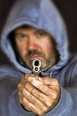 picture of gang  - Thief or gang member holding handgun in a threatening position - JPG