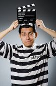 picture of inmate  - Inmate with movie clapper board - JPG