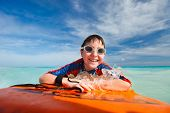 pic of boogie board  - Little boy on vacation having fun swimming on boogie board - JPG