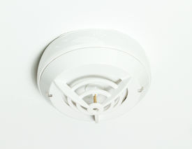 stock photo of smoke detector  - Smoke detector attached to the white ceiling - JPG