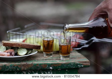Person Pouring Brandy