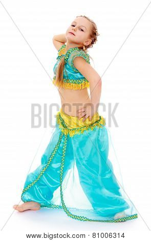 Adorable little girl in oriental costume.