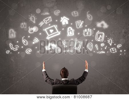 Business man looking at modern icons and symbols concept