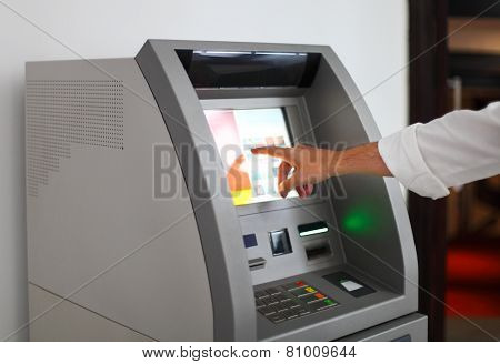 Man Using Banking Machine