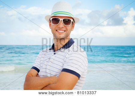 Portrait Of Young Smiling Caucasian Man On Sea Coast