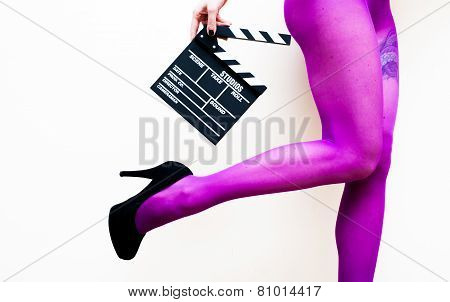 Female Legs In Pink Pantyhose And Black High Heels With Movie Clapper