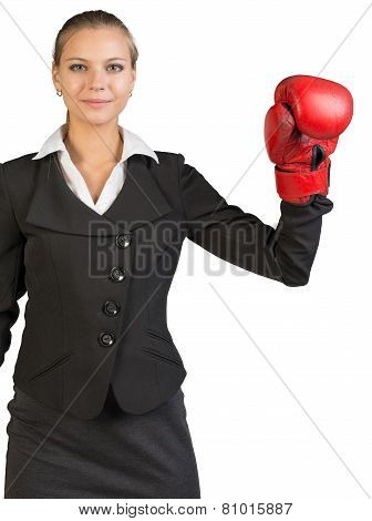 Cropped image of businesswoman wearing boxing gloves