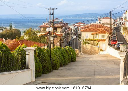 PYLOS, GREECE - OCT 6, 2014: One of the streets of Pylos island. Modern town of Pylos, was built by the troops of General Maison during the subsequent French Morea expedition of 1828-1833.