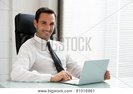 businessman smiling and pointing finger