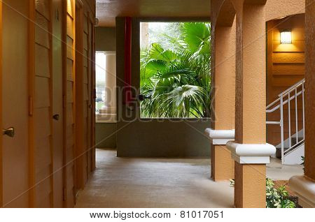Outside Hallway With With Doors And Rain